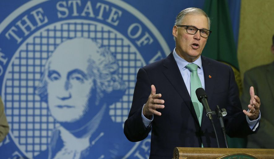 Washington Gov. Jay Inslee talks to reporters about his proposed budget, Wednesday, Dec. 14, 2016, in Olympia, Wash. While the bulk of Inslee's proposal focuses on education funding, his two-year plan also seeks more money for mental health and a tuition freeze for universities and community and technical colleges. (AP Photo/Ted S. Warren)