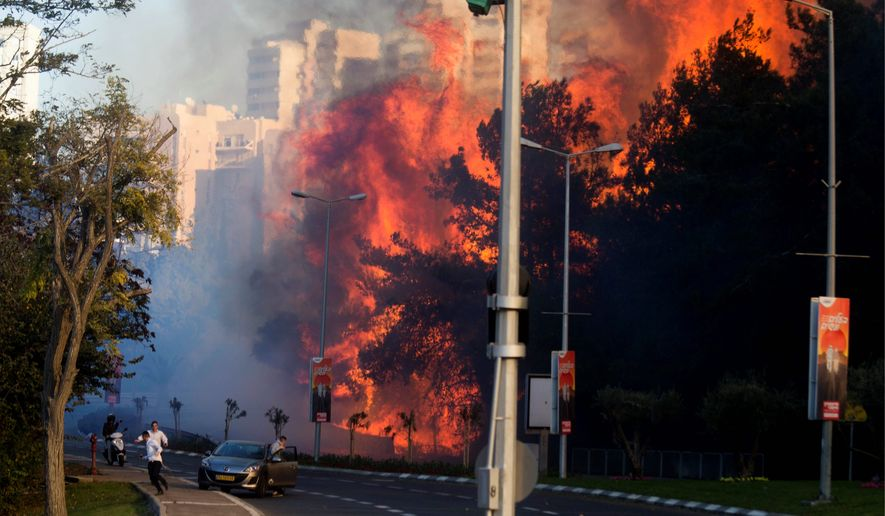 Thousands of brush fires have forced more than 100,000 Israelis to evacuate and have destroyed or damaged more than 500 homes as Palestinians change tactics in the wake of the Third Intifada. (Associated Press)