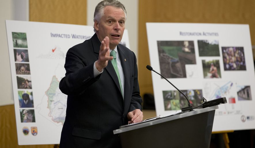 Virginia Gov. Terry McAuliffe gestures during a news conference at the Capitol in Richmond, Va., Thursday, Dec. 15, 2016. McAuliffe announced a proposed $50 million settlement to resolve claims stemming from the release of mercury from the former E.I. du Pont de Nemours and Company (DuPont) facility in Waynesboro, Virginia (AP Photo/Steve Helber)