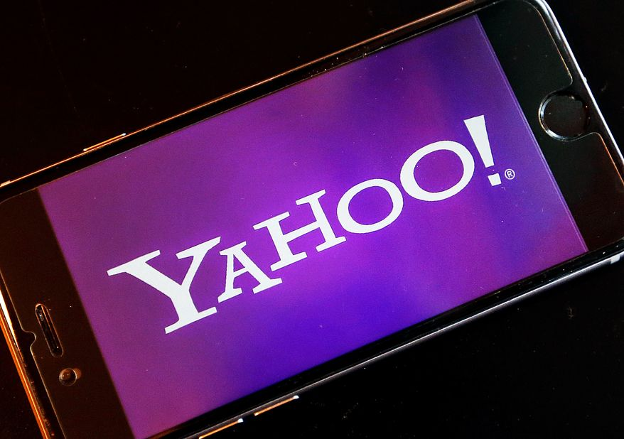 The logo of YAHOO appears on a smartphone in Frankfurt, Germany, Thursday, Dec. 15, 2016. On Wednesday, Dec. 14, 2016, Yahoo said it believes hackers stole data from more than one billion user accounts in August 2013. (AP Photo/Michael Probst)