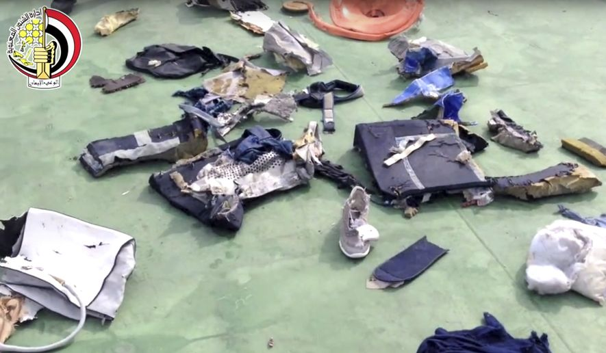 This still file image taken from video posted Saturday, May 21, 2016, on the official Facebook page of the Egyptian Armed Forces spokesman shows some personal belongings and other wreckage from EgyptAir Flight 804. (Egyptian Armed Forces via AP)