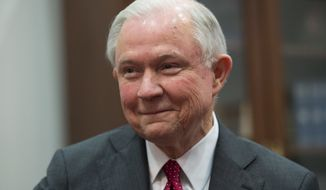 In this Nov. 29, 2016 photo, Attorney General-designate, Sen. Jeff Sessions, R-Ala. smiles on Capitol Hill in Washington, as President-elect Donald Trump fills out his Cabinet. (AP Photo/Molly Riley, File)