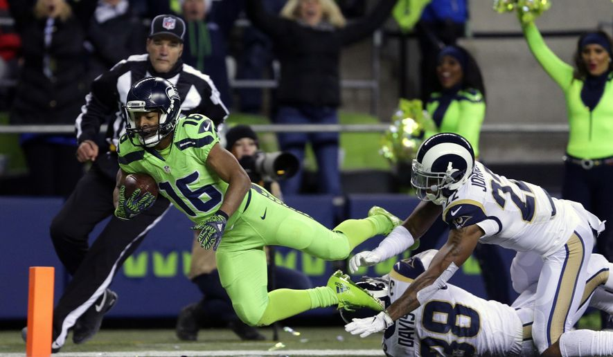 Seattle Seahawks wide receiver Tyler Lockett (16) scores a touchdown ahead of Los Angeles Rams cornerback Trumaine Johnson (22) after a reception in the second half of an NFL football game, Thursday, Dec. 15, 2016, in Seattle. (AP Photo/Scott Eklund)