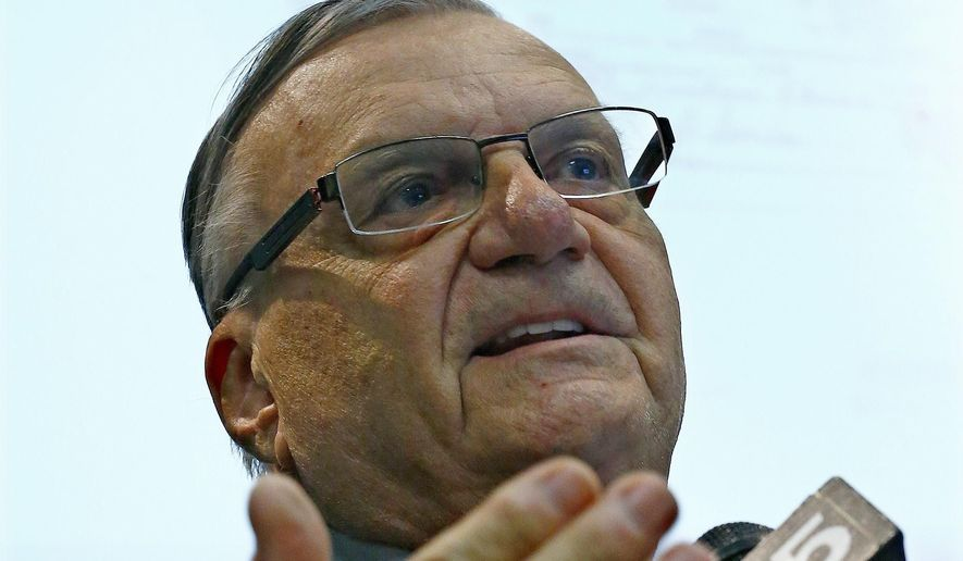 Maricopa County Sheriff Joe Arpaio speaks to the findings of a five-year investigation into the authenticity of President Barack Obama's birth certificate during a press conference Thursday, Dec. 15, 2016, in Phoenix. He earned plaudits from Donald Trump and became one of the nation's leading voices on the debunked controversy over Obama's birthplace (AP Photo/Ross D. Franklin)