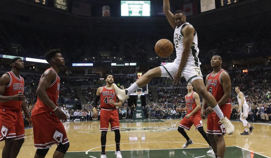 Milwaukee Bucks' Jabari Parker dunks during the second half of an NBA basketball game against the Chicago Bulls Thursday, Dec. 15, 2016, in Milwaukee. The Bucks won 108-97. (AP Photo/Morry Gash)