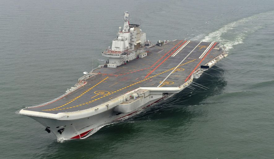 FILE - In this May 2012 file photo provided by China's Xinhua News Agency, Chinese aircraft carrier Liaoning cruises for a test in the sea. On Thursday China's Defense Ministry says the country's first aircraft carrier battle group has carried out its first live-fire exercise. (AP Photo/Xinhua, Li Tang, File)