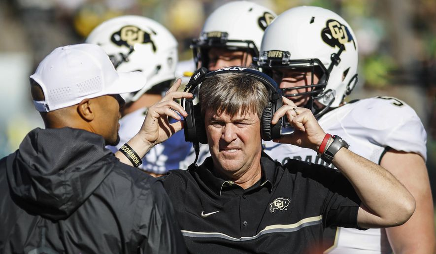 FILE - In this Sept. 24, 2016, file photo, Colorado head coach Mike MacIntyre works the sidelines against Oregon in an NCAA college football game, in Eugene, Ore. Colorado's Mike MacIntyre is The Associated Press college football Coach of the Year after leading the Buffaloes to a 10-3 record and their first bowl game since 2007.  In four years, MacIntyre's turned a program that was regarded as one of the nation's worst into a Pac-12 title contender. (AP Photo/Thomas Boyd, File)
