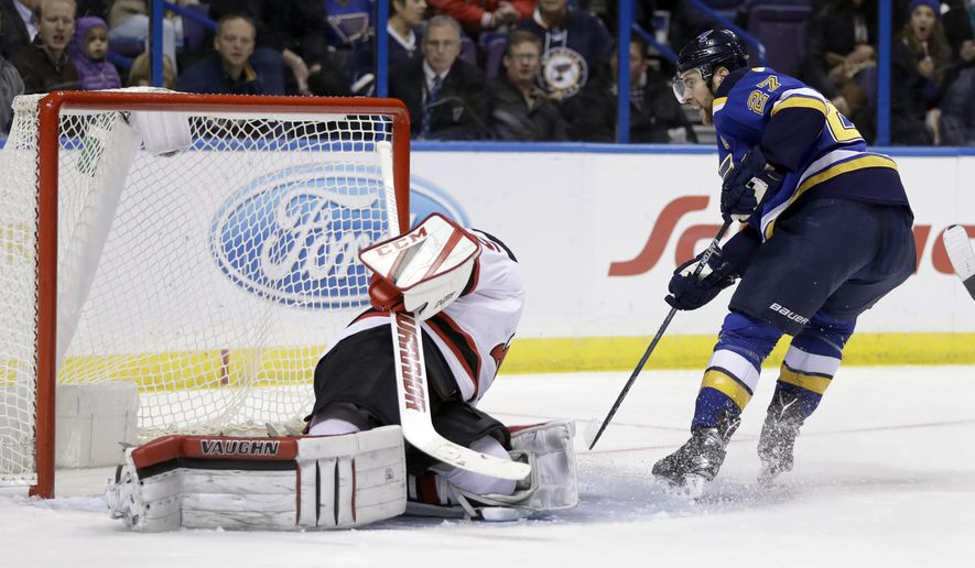 St. Louis Blues' Alex Pietrangelo, right, scores past New Jersey Devils goalie Cory Schneider during the second period of an NHL hockey game Thursday, Dec. 15, 2016, in St. Louis. (AP Photo/Jeff Roberson)