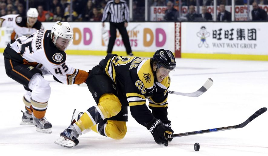 Boston Bruins right wing David Pastrnak (88) chases the puck for a shot on goal as Anaheim Ducks defenseman Sami Vatanen (45) pursues in the second period of an NHL hockey game, Thursday, Dec. 15, 2016, in Boston. (AP Photo/Elise Amendola)