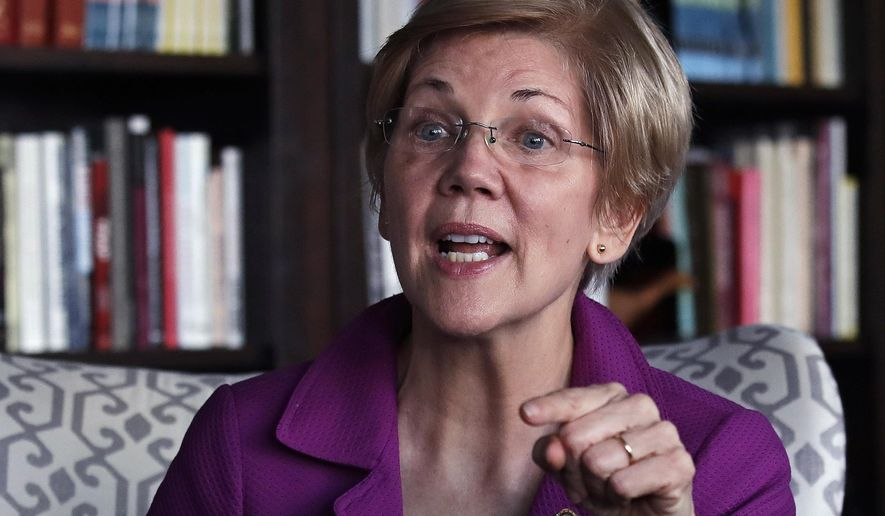Sen. Elizabeth Warren, Massachusetts Democrat, gestures as she answers a question during an interview at her office in Boston on Dec. 15, 2016. (Associated Press) **FILE**