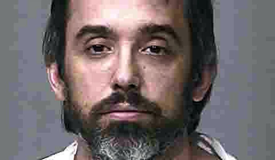 """This Wednesday, Dec. 14, 2016 booking photo provided by the Scottsdale, Ariz., Police Department shows Matthew Libman. Scottsdale police say Libman, 38, was arrested Wednesday in the death of his father, Kip Libman, 73, whose body was found in his home after officers responded to a call from the son. According to police, there was evidence of """"an obvious struggle"""" inside the home and investigators determined that the father and son had fought. (Scottsdale Police Department via AP)"""