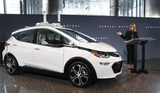 General Motors Chairman and Chief Executive Officer Mary Barra speaks next to a autonomous Chevrolet Bolt electric car Thursday, Dec. 15, 2016, in Detroit. General Motors has started testing fully autonomous vehicles on public roads around its technical center in suburban Detroit. (AP Photo/Paul Sancya) ** FILE **