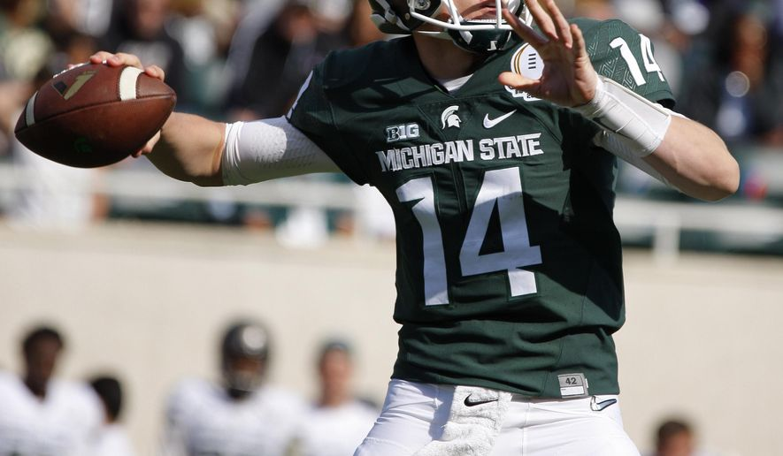 "File - In this April 23, 2016, file photo, Michigan State green quarterback Brian Lewerke throws a pass during the second half of the team's spring NCAA college football game, Saturday, April 23, 2016, in East Lansing, Mich. Michigan State coach Mark Dantonio says is ""the guy to beat out"" at quarterback as the Spartans look ahead to 2017. (AP Photo/Al Goldis, File)"