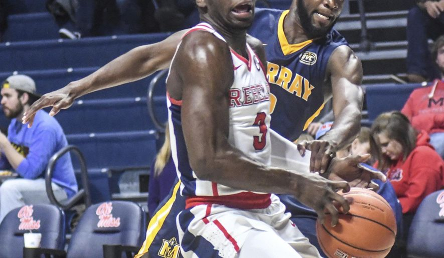 Mississippi guard Terence Davis (3) is defended by Murray State guard Jonathan Stark (2) during an NCAA college basketball game, Thursday, Dec. 15, 2016 in Oxford, Miss. (Bruce Newman/The Oxford Eagle via AP)