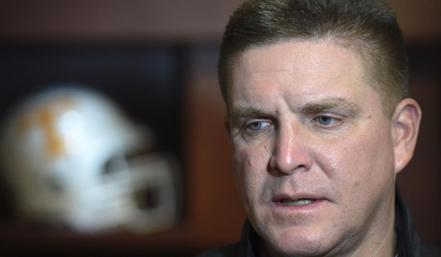 "FILE - In this Jan. 12, 2016, file photo, Tennessee's defensive coordinator, Bob Shoop, answers questions during a news conference in Knoxville, Tenn. Tennessee (8-4) hopes the end of the regular season helps the defense recharge heading into the Dec. 30 Music City Bowl with No. 24 Nebraska (9-3) at Nashville, Tennessee. ""You hit the reset button,"" says Shoop. ""It's a fresh start."" (Amy Smotherman Burgess/Knoxville News Sentinel via AP, File)"