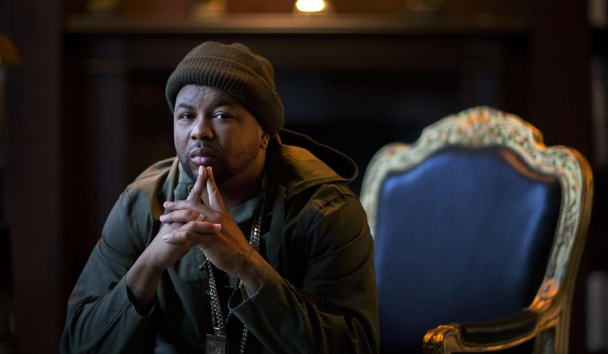 In this Wednesday, Dec. 14, 2016 photo, The-Dream sits for a portrait at his home in Atlanta. The-Dream is reaping the benefits of a stellar music career inside his lavish Atlanta home in an area where the singer dreamed of living when he worked a few blocks away more than decade ago. (AP Photo/David Goldman)