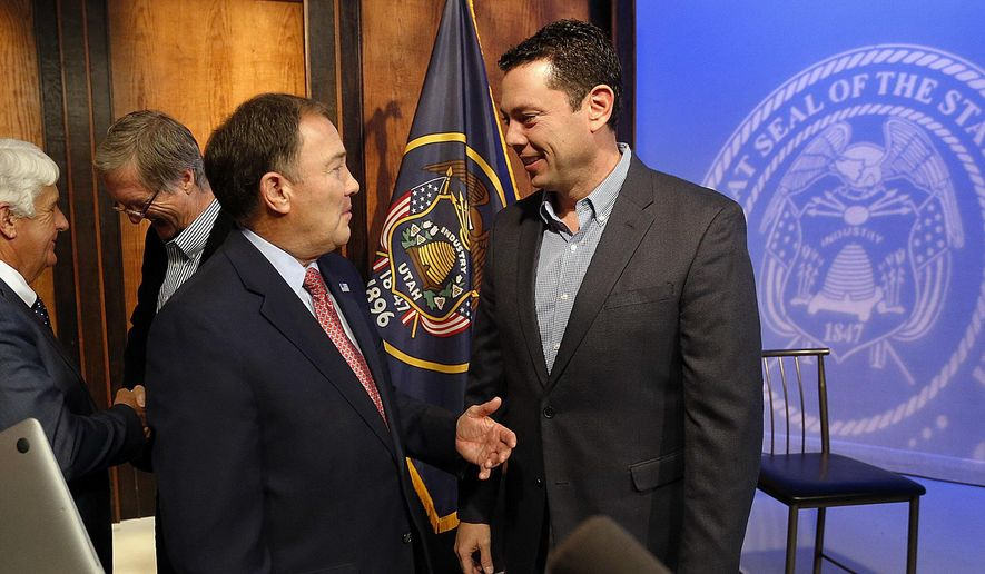Utah Gov. Gary Herbert, front left, talks with Rep. Jason Chaffetz, R-Utah, following the governor's monthly news conference at KUED-TV in Salt Lake City on Thursday, Dec. 15, 2016. At back left, Rep. Rob Bishop, R-Utah, talks with Bob Bernick. (Ravell Call/The Deseret News via AP)
