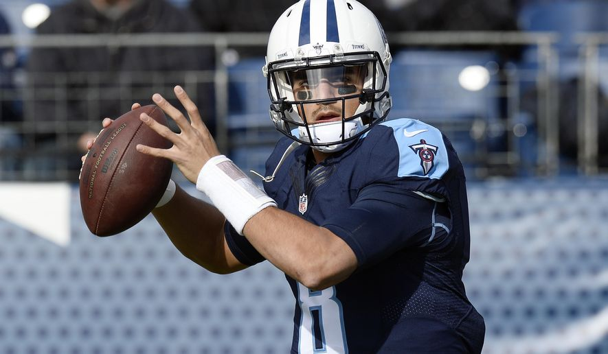 FILE - In this Sunday, Dec. 11, 2016 file photo, Tennessee Titans quarterback Marcus Mariota warms up before an NFL football game against the Denver Broncos in Nashville, Tenn. The Tennessee Titans are making believers out of lots of folks. The idea that they could win the AFC South is very much alive after their victory over Denver. Should the Titans come out of Kansas City with another win on Sunday, Dec. 18, 2016, the question might become are they good enough to not only make the playoffs, but do damage there.(AP Photo/Mark Zaleski, File)