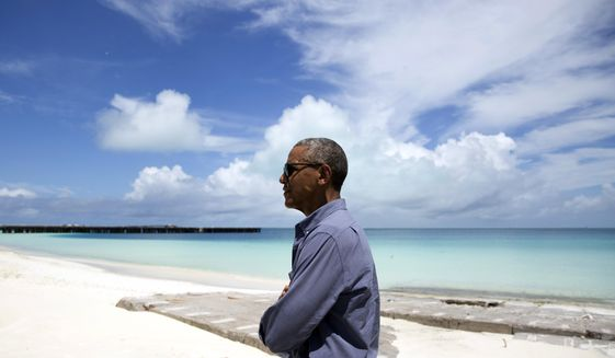 FILE - In this Sept. 1, 2016, file photo, President Barack Obama looks out over Turtle Beach as he tours Midway Atoll in the Papahanaumokuakea Marine National Monument, Northwestern Hawaiian Islands. Obama will leave behind a host of disputed actions and unfinished business on the environment, from blocked energy leases and mining projects to recent pollution restrictions and decisions on hundreds of potentially-imperiled species. Republicans emboldened by Donald Trump's victory are gearing up to reverse many of the administration's signature environmental moves. (AP Photo/Carolyn Kaster, File)