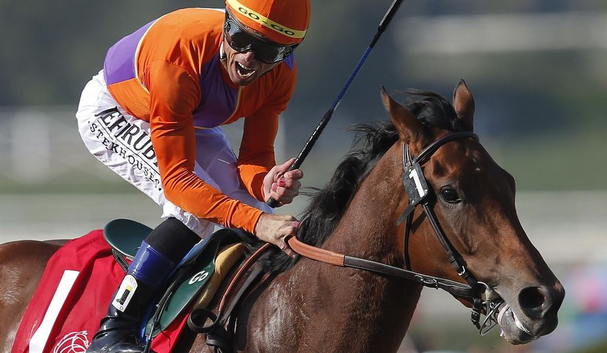 FILE - In this Nov. 2, 2012, file photo, jockey Garrett Gomez reacts aboard Beholder after crossing the finish line to win the Juvenile Fillies horse race at the Breeders' Cup in Arcadia, Calif. Gomez, who won nearly 4,000 races in a 25-year career and was among the greatest jockeys of the first decade of the 21st century, has died in southern Arizona. He was 44. Authorities with the Pascua Yaqui Tribe said Thursday, Dec. 15, 2016, that Gomez was found unconscious on the floor of a hotel room Wednesday and pronounced dead at the scene. They say foul play isn't suspected(AP Photo/Jae C. Hong, File)