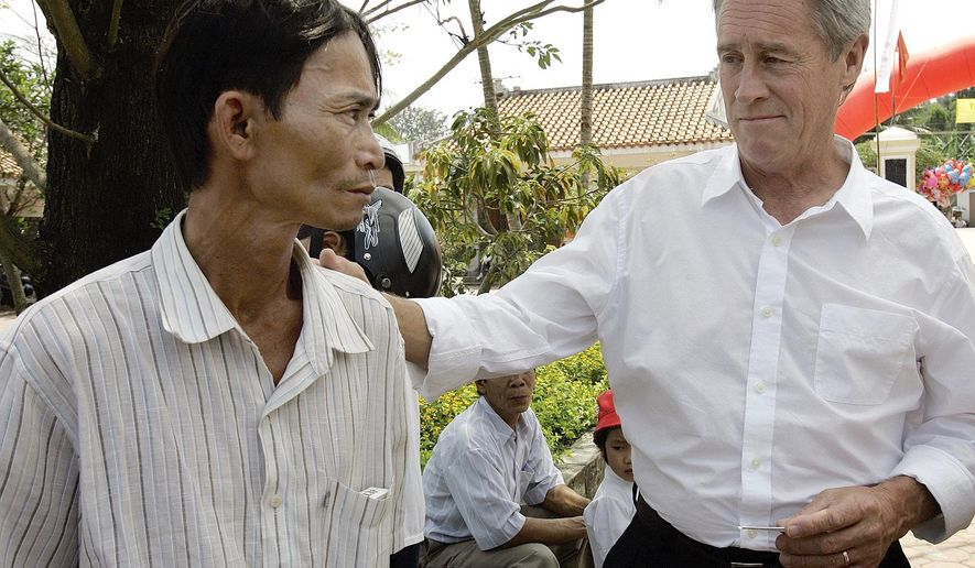 FILE - In this Saturday, March 15, 2008 file photo, My Lai Massacre survivor Do Ba, 48, left, stands with former U.S. Army officer Lawrence Colburn, 58, right, who rescued him during the March 16, 1968 My Lai massacre, during the 40th anniversary of the incident in My Lai, Quang Ngai Province, Vietnam. Colburn, the helicopter gunner who helped end the slaughter of hundreds of unarmed Vietnamese villagers by American troops during the Vietnam War, died on Tuesday, Dec. 13, 2016. He was 67. (AP Photo/Chitose Suzuki)
