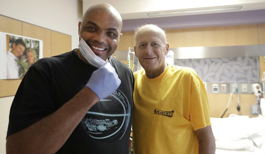 FILE - In this Aug. 31, 2016, file photo, NBA Hall of Fame member and TNT colleague Charles Barkley, left, poses with longtime NBA sideline reporter Craig Sager while visiting Sager at MD Anderson Cancer Center in Houston. Sager,  famous for his flashy suits and probing questions, has died after a batter with cancer, Turner Sports announced Thursday, Dec. 15, 2016. He was 65. (AP Photo/David J. Phillip, File)