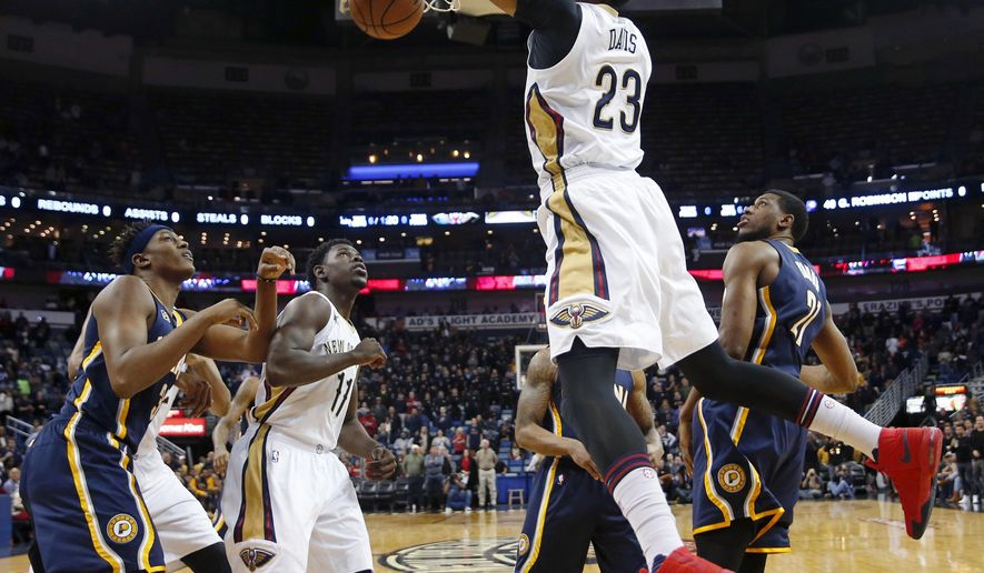 New Orleans Pelicans forward Anthony Davis (23) slam dunks in the first half of an NBA basketball game against the Indiana Pacers in New Orleans, Thursday, Dec. 15, 2016. (AP Photo/Gerald Herbert)