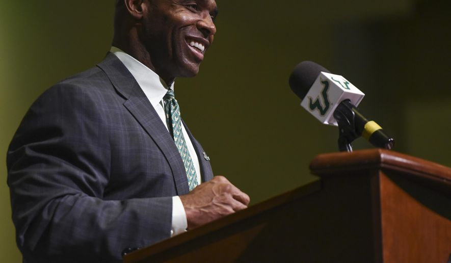 South Florida's new NCAA college football head coach Charlie Strong smiles during a press conference at the University of South Florida in Tampa, Fla., Thursday, Dec. 15, 2016. (Andres Leiva/The Tampa Bay Times via AP) /