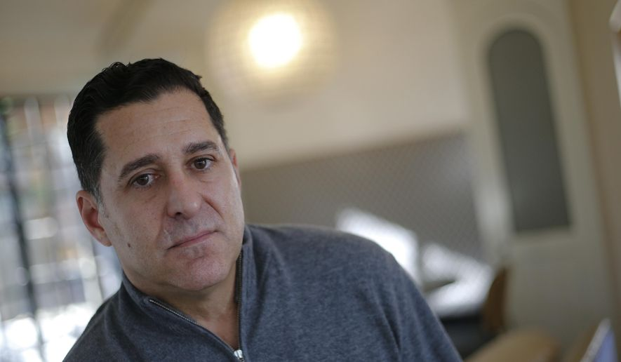 "In this Thursday, Dec. 15, 2016 photo, American software company manager Bart Fanelli poses for a portrait in his home, in Atlanta. Fanelli said he didn't know a British court had found that he sexually harassed a woman at a company conference until he saw his photo splashed across a British tabloid's website accusing him of saying he wanted to eat the woman ""like a marshmallow."" (AP Photo/John Bazemore)"