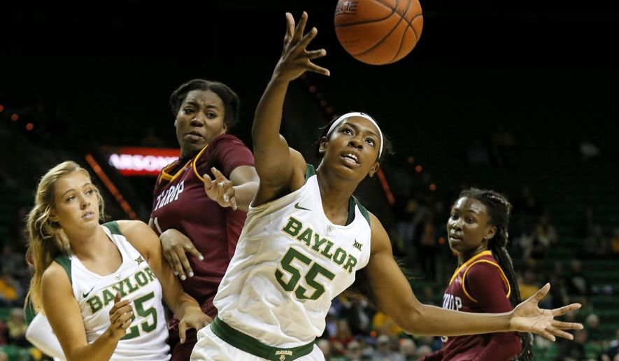 Baylor forward/center Khadijiah Cave (55) collects a defensive rebound in front of Alyssa Dry (25), Winthrop's Amari Grevious, center rear, and Danyeal Goodhope, right, in the first half of an NCAA college basketball game, Thursday, Dec. 15, 2016, in Waco, Texas. (AP Photo/Tony Gutierrez)