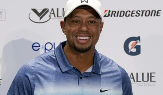 FILE - In this Oct. 20, 2015, file photo, Tiger Woods arrives for a press conference to launch Bridgestone America's Golf Cup in Mexico City. One tournament into his return was all Tiger Woods needed to strike a deal with Bridgestone to play its golf ball. Bridgestone Golf said Thursday, Dec. 15, 2016, it has signed Woods to a multi-year agreement in which he will play and promote the golf ball.  (AP Photo/Rebecca Blackwell, File)
