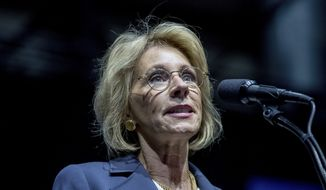 FILE - In this Dec. 9, 2016 file photo, Education Secretary-designate Betsy DeVos speaks in Grand Rapids, Mich. Propelled by populist energy, President-elect Donald Trumps candidacy broke long-standing conventions and his incoming Cabinet embodies a sharp turn from the outgoing Obama administration.  (AP Photo/Andrew Harnik, File)