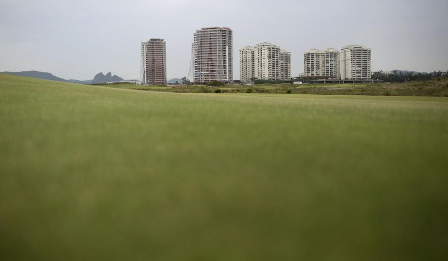 "This Dec. 14, 2016 photo shows a view of the Olympic golf course in Rio de Janeiro, Brazil. Billed as the first public, championship-level course in the country, the layout is hidden behind several luxury apartment towers known as ""Riserva Golf,"" which won't be completed until 2018. (AP Photo/Silvia Izquierdo)"