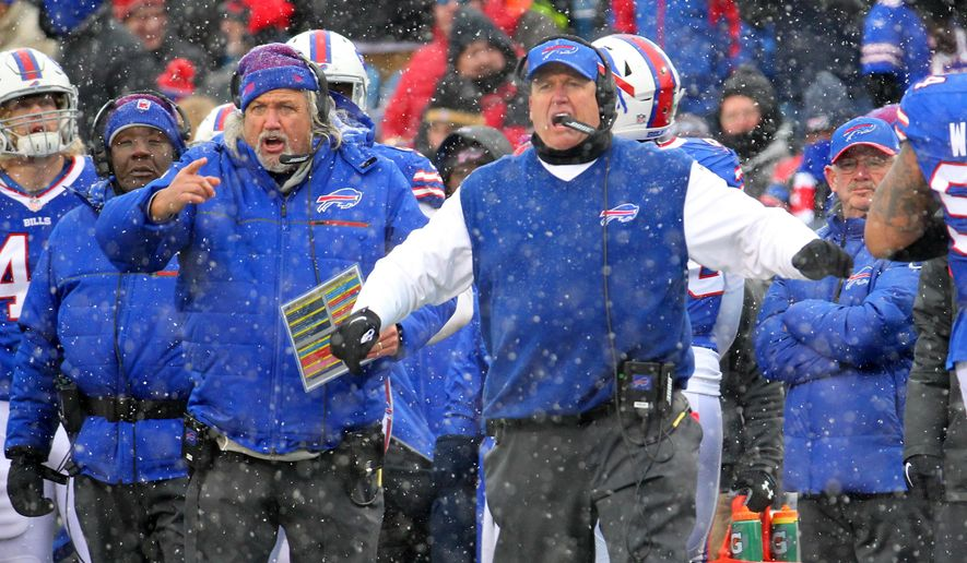 """FILE - In this Dec. 11, 2016, file photo, Buffalo Bills head coach Rex Ryan, right, and his brother, assistant head coach Rob Ryan, left, react during the second half of an NFL football game against the Pittsburgh Steelers in Orchard Park, N.Y. When asked if two seasons are enough to judge a coach, Rex smiled and said: """"I think three years is better.""""(AP Photo/Bill Wippert, File) **FILE**"""