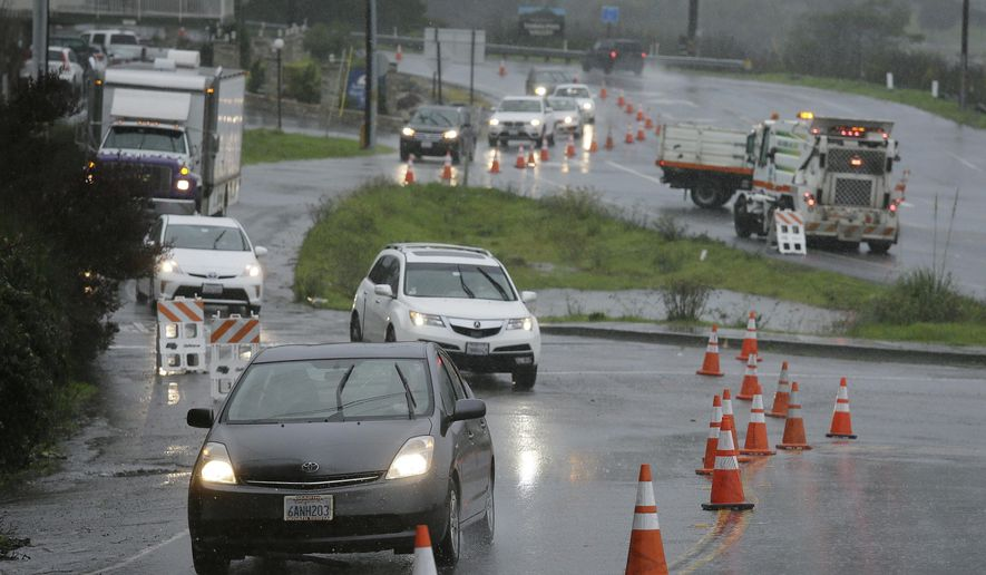 Traffic is diverted around flooded areas Thursday, Dec. 15, 2016, in Mill Valley, Calif. One of the strongest rainstorms of the season hit the San Francisco Bay Area on Thursday, with a small town in the North Bay receiving nearly seven inches of rain over the last 24-hour period, forecasters said. Flash-flood warnings are in effect for southern Sonoma County and northern Marin County. (AP Photo/Eric Risberg)