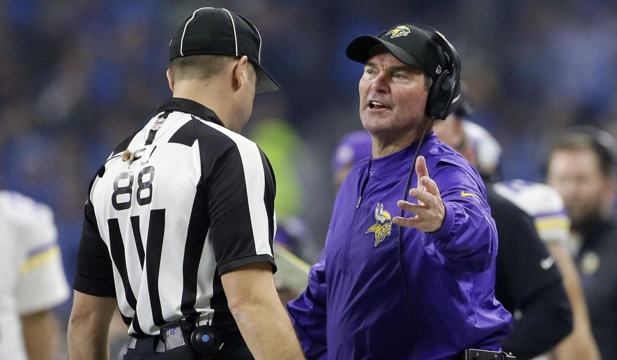 FILE - In this Thursday, Nov. 24, 2016 file photo, Minnesota Vikings head coach Mike Zimmer talks with field judge Brad Freeman during the second half of an NFL football game against the Detroit Lions in Detroit. From Aaron Rodgers to Eli Manning, Cam Newton to Marcus Mariota, Mike Zimmer has devised game plans that have made some of the league's best and most dynamic quarterbacks look like lifelong backups. Next up for the Minnesota Vikings' defensive mastermind, Andrew Luck. The Vikings play the Indianapolis Colts on Sunday, Dec. 18, 2016. (AP Photo/Duane Burleson, File)