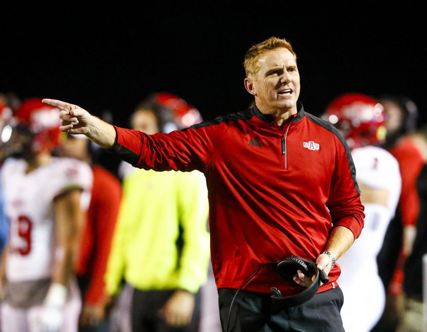 FILE - In this Nov. 17, 2016, file photo, Arkansas State coach Blake Anderson reacts to a call during the second half of the team's NCAA college football game against Troy, in Troy, Ala. Arkansas State and UCF certainly have a lot in common heading into Saturday's AutoNation Cure Bowl matchup.Both are led by their defenses, have developing high-octane offenses and have made the postseason after impressive turn-around seasons. (AP Photo/Butch Dill, File)