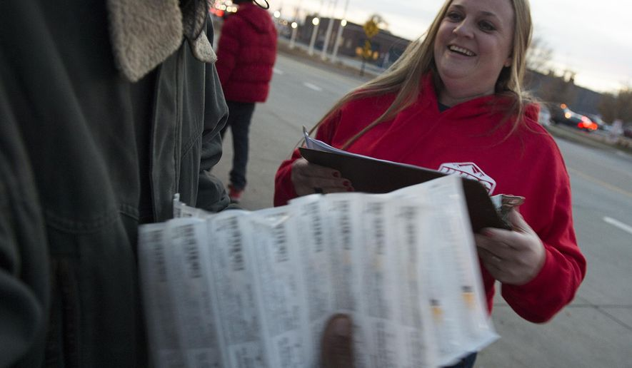 ADVANCE FOR WEEKEND EDITIONS, DEC. 17-18-  In this Dec 9, 2016 photo, Mindy Vincent, who estimates she's handed out 3,200 syringes to heroin addicts, distributes syringes along Rio Grande St. in downtown Salt Lake City. Vincent, a licensed social worker established Utah Harm Reduction Coalition, a nonprofit to hand out the syringes through the syringe exchange program started by the state in 2016. (Leah Hogsten/The Salt Lake Tribune via AP)