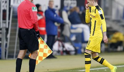 Dortmund's Marco Reus leaves the pitch after he received a red card during a German first division Bundesliga soccer match between TSG 1899 Hoffenheim and Borussia Dortmund in Sinsheim, Germany, Friday, Dec. 16, 2016.(AP Photo/Michael Probst)