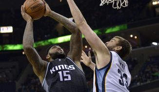 Sacramento Kings forward DeMarcus Cousins (15) shoots against Memphis Grizzlies center Marc Gasol (33) in the first half of an NBA basketball game Friday, Dec. 16, 2016, in Memphis, Tenn. (AP Photo/Brandon Dill)
