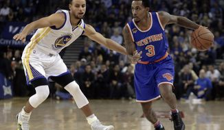 New York Knicks' Brandon Jennings, right, drives the ball against Golden State Warriors' Stephen Curry during the first half of an NBA basketball game Thursday, Dec. 15, 2016, in Oakland, Calif. (AP Photo/Ben Margot)