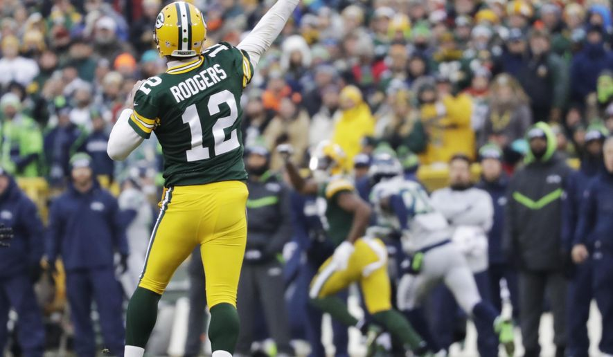 FILE - In this Dec. 11, 2016, file photo, Green Bay Packers' Aaron Rodgers throws a touchdown pass to Davante Adams during the first half of an NFL football game against the Seattle Seahawks, in Green Bay, Wis. The Packers come into Sunday's game against the Chicago Bears at Soldier Field with three straight wins after dropping four in a row and renewed hope if not much room for error. (AP Photo/Morry Gash, File)