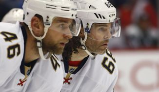 Florida Panthers right wing Jaromir Jagr, right, waits with defenseman Jakub Kindl, (46) both of the Czech Republic, for a face off against the Colorado Avalanche in the first period of an NHL hockey game Friday, Dec. 16, 2016, in Denver. (AP Photo/David Zalubowski)