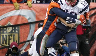 FILE - In this Jan. 24, 2016, file photo, New England Patriots quarterback Tom Brady is sacked by Denver Broncos outside linebacker Von Miller during the second half of the NFL football AFC Championship game in Denver. Brady suffered the worst beating of his career in the AFC championship in Denver last season when the Broncos hit him nearly two dozen times. The Broncos take on the Patriots on Sunday. (AP Photo/Charlie Riedel, File)