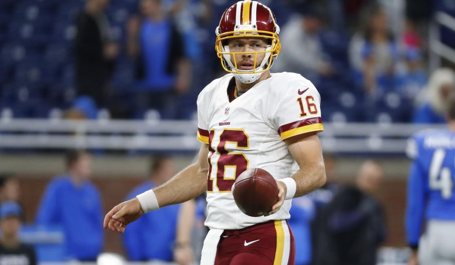 FILE - In this Oct. 24, 2016, file photo, Washington Redskins quarterback Colt McCoy (16) warms up before an NFL football game against the Detroit Lions in Detroit. Quarterback Colt McCoy is the emergency long snapper for the Redskins, who watched the Eagles use three guys at that position in a 27-22 win at Philadelphia last Sunday. (AP Photo/Paul Sancya, File)