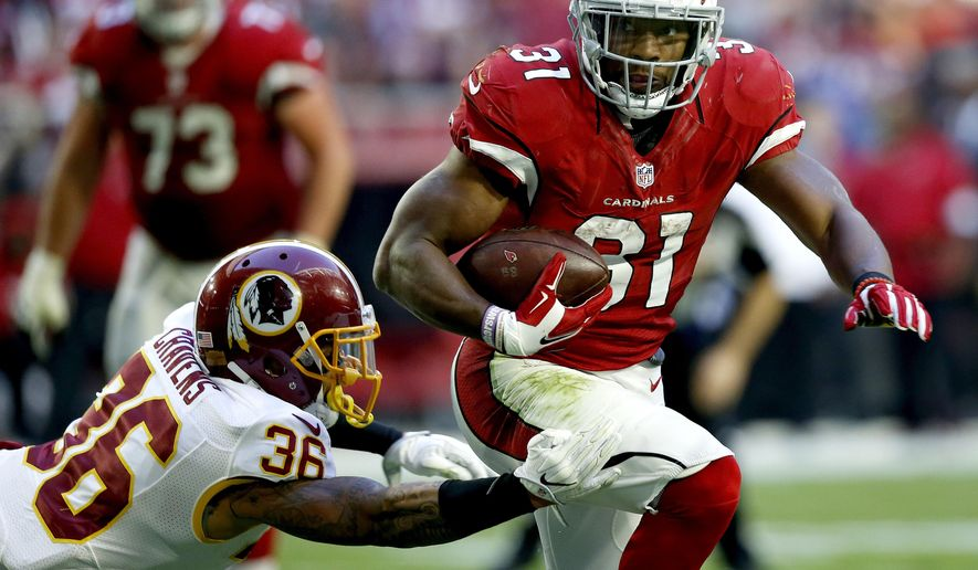 FILE - In this Sunday, Dec. 4, 2016 file photo, Arizona Cardinals running back David Johnson (31) runs as Washington Redskins inside linebacker Su'a Cravens (36) defends during the second half of an NFL football game in Glendale, Ariz. The Cardinals play the New Orleans Saints on Sunday, Dec. 18, 2016. (AP Photo/Ross D. Franklin, File)
