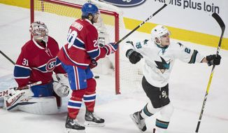 Montreal Canadiens goaltender Carey Price looks back on his net after being scored on by San Jose Sharks' Timo Meier (28) as Canadiens' Zach Redmond (20) defends during the first period of an NHL hockey game, Friday, Dec. 16, 2016 in Montreal. (Graham Hughes/The Canadian Press via AP)