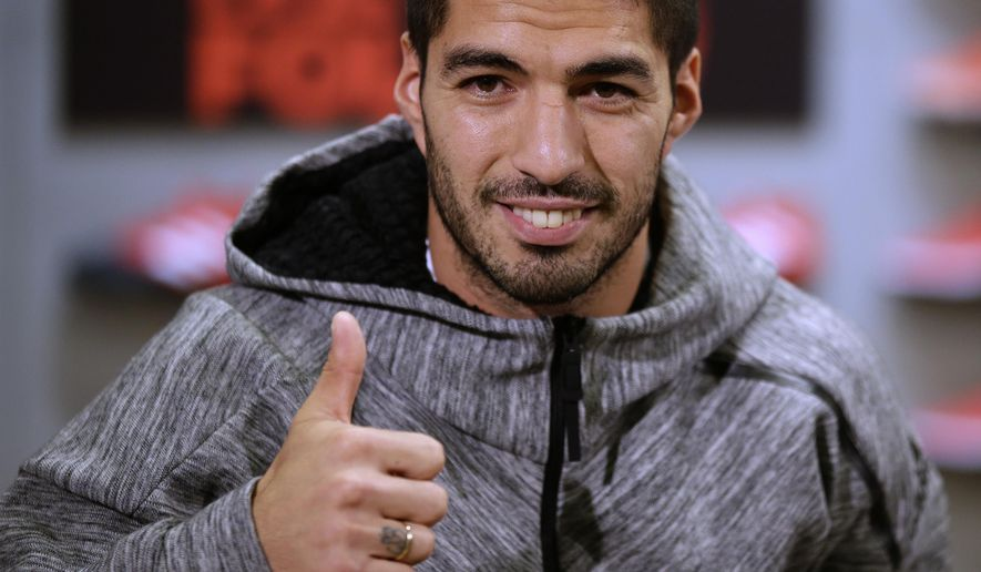 FC Barcelona's Luis Suarez poses for the media during a promotional event in Barcelona, Spain, Thursday, Dec.15, 2016. Barcelona says it has reached a deal to extend the contract of Uruguay striker Luis Suarez to June 2021. The club says the new contract which has a buyout clause of 200 million euros ($210 million) will be signed on Friday. (AP Photo/Manu Fernandez)