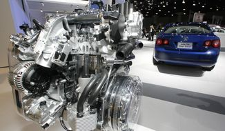 "In this Nov. 20, 2008, file photo a Volkswagen Jetta TDI diesel engine is displayed at the Los Angeles Auto Show. Then Green Car Journal named Volkswagen's 2009 Jetta TDI as the ""Green Car of the Year"" at the show on Thursday, making it the first clean-diesel vehicle to win the prize. A federal judge in San Francisco is set to hear Friday, Dec. 16, 2016, whether Volkswagen, U.S. regulators and attorneys for car owners have reached a deal for the remaining 80,000 cars caught up in the company's emissions cheating scandal. (AP Photo/Damian Dovarganes, File)"
