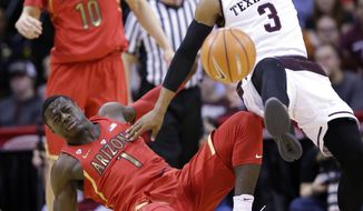 Texas A&M's Admon Gilder (3) collides with Arizona's Rawle Alkins (1) while chasing a loose ball during the first half of an NCAA college basketball game, Saturday, Dec. 17, 2016, in Houston. (AP Photo/David J. Phillip)